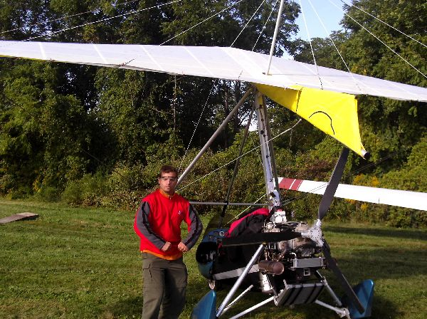 Chris Miller posing in front of an ultralight