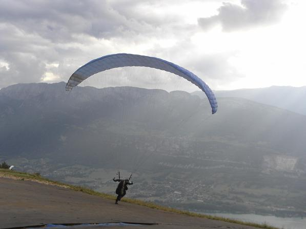Jason Andrews launching his paraglider from Col de la Forclaz, Annecy