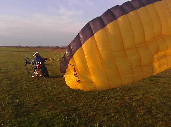 Dan launches well despite his paraglider being soaked