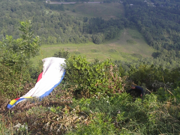 Mukrim recovering his paraglider
